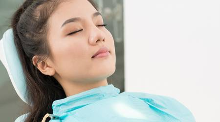 IV-Sedation-Dentistry-Woman-Sleeping-Dentist-Chair.jpg